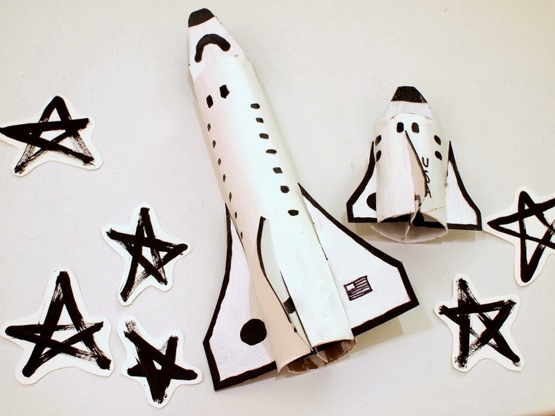 make some cardboard space shuttles with your kids