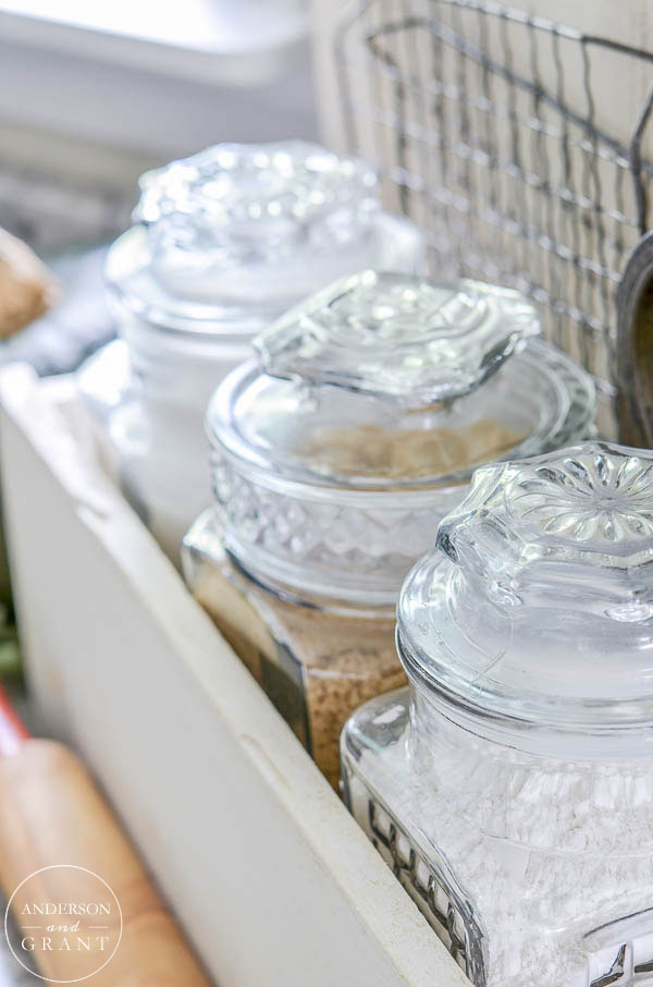 Use mismatched glass canisters from the thrift store to store your baking necessities like flour and sugar.  |  www.andersonandgrant.com