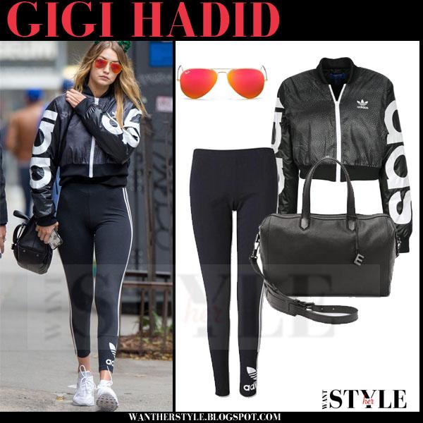 Gigi Hadid in black crop track adidas mystic moon jacket and black leggings what she wore models off duty