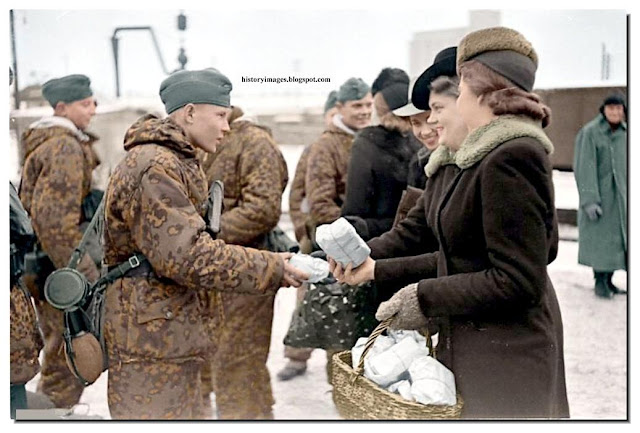 Waffen SS boys get food from  Waffen Ss Color
