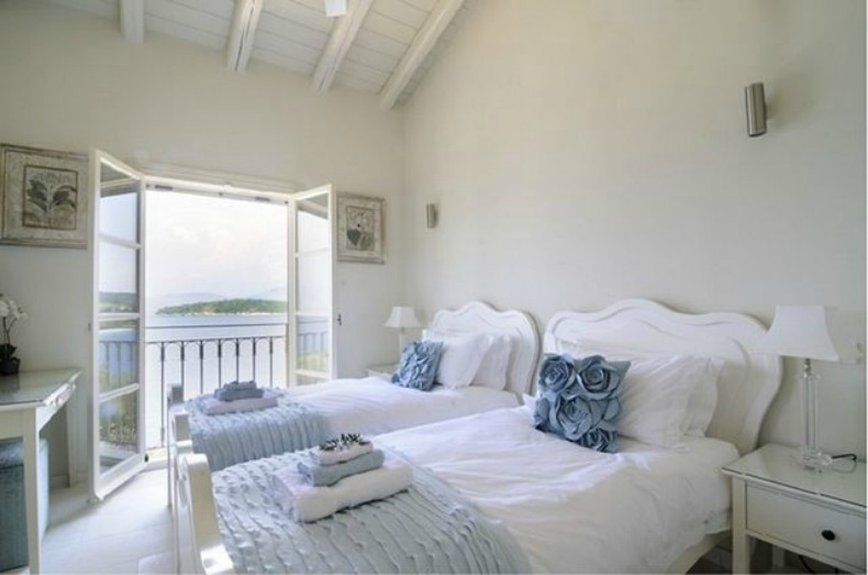 white guest bedroom with lovely coastal views