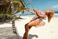Sylvie van der Vaart on the swing at the beach