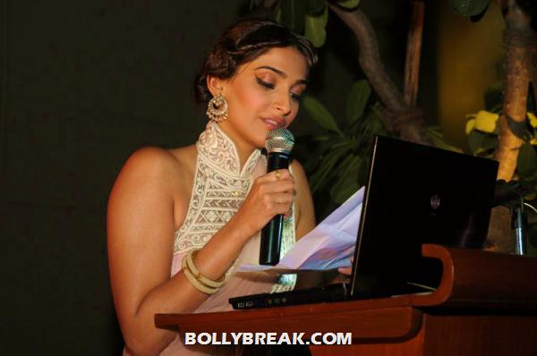 sonam kapoor on stage with mic -  Sonam Kapoor in beige peach sari