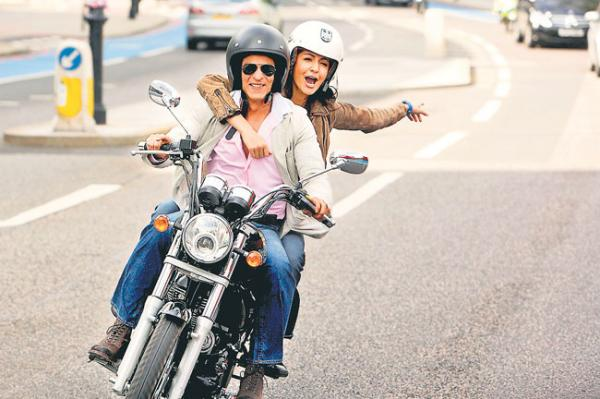 Shahrukh khan and Anushka Sharma riding a bike with helmets from their movie - London Ishq - Shah Rukh and Anushka - London Ishq Stills : Movies, Parties