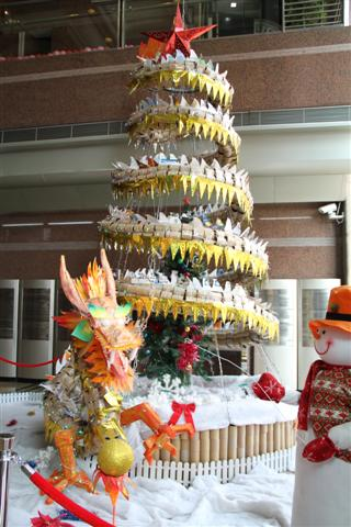 the christmas tree was still up in the lobby decorated by the dragon made from office supply stuff - Office Supply Christmas Decorations