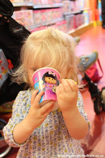Toddler drinking from a Cabbage Patch Kids paper cup