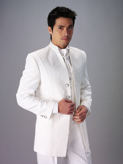 The groom 39s suit or tuxedo should vary slightly from his attendants 39 so that