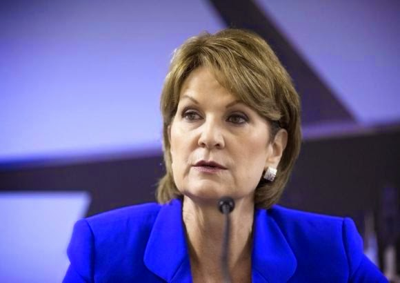 Chief Executive Officer of Lockheed Martin Corp Marillyn Hewson speaks to journalists at a news conference at the 2014 Farnborough International Airshow in Farnborough, southern England July 14, 2014.  (Credit: Reuters/Kieran Doherty) Click to enlarge.