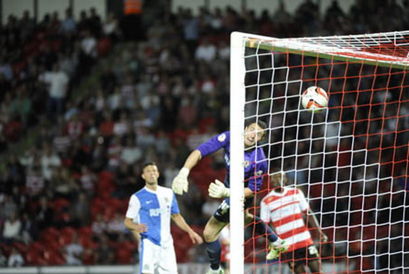 Blackburn goalkeeper Jake Kean is unable to save a freak goal from Doncaster's James Husband