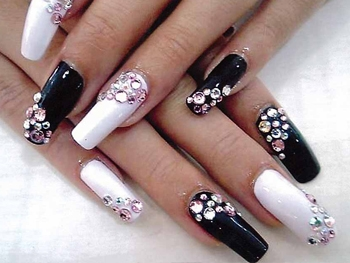 Contrasting White and Black Nail Art Accented with Stones