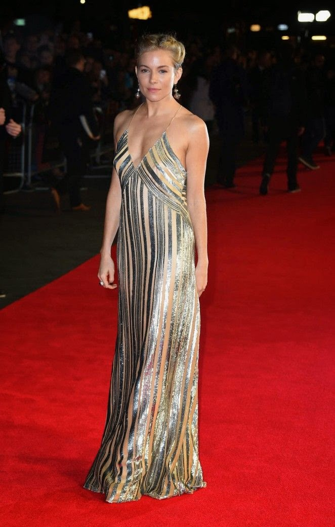 It's clear that Sienna Miller is a leading lady and also on the red carpets she is appearing on. Just when we'd finally gotten over how fabulous her on the last ensemble was, the 32-year-old went and wore this gown at the Premiere of Foxcatcher in London on Thursday, October 16, 2014.