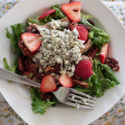 The Best Salad Ever:  A green salad topped with blue cheese, chicken, strawberries, and candied pecans.
