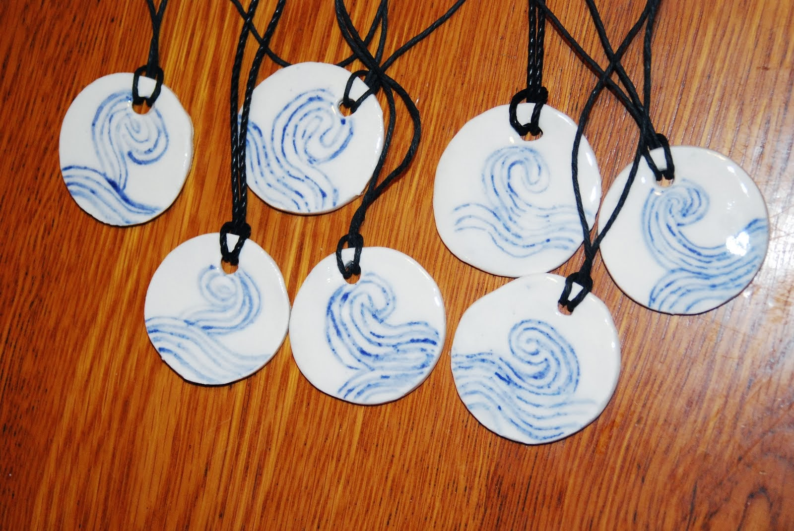 Win a Spiral Pendant on the Happy Holidays Book Blog Hop during Dec. 1-15th