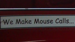 sticker on pest control truck that says we make mouse calls