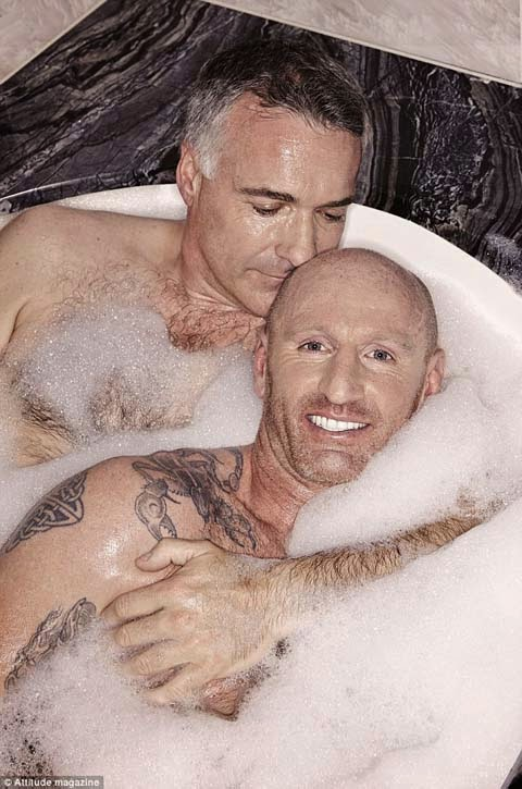 Rugby superstar Gareth Thomas poses with boyfriend of one year Ian baum in a bubble bath naked