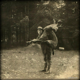 creepy scary weird wtf vintage photo image man deer hunter dead
