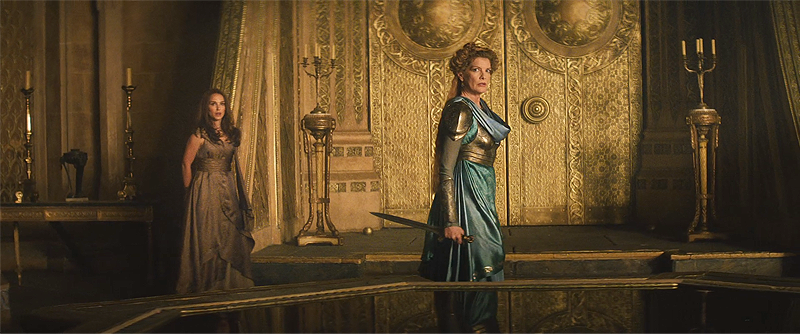 Frigga and Jane Foster as Malekith enters and fights Frigga