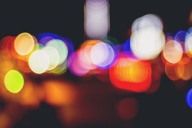 Blurred, hazy colourful city lights at night