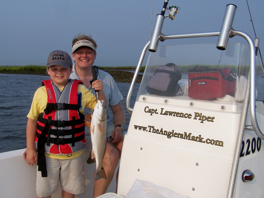 boy with redfish