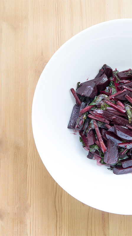 Young beet with leaves in warm salad top