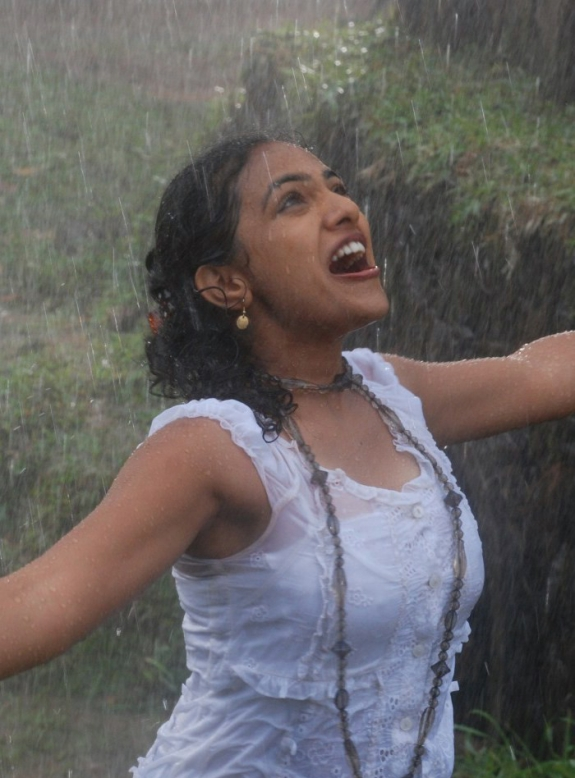 ... rain song tamil actress images nithya menon new wet photos in rain