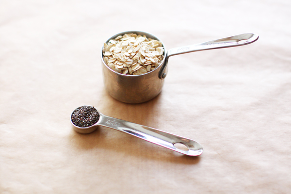 Healthy breakfast ingredients: old-fashioned oatmeal with chia seeds