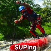A man Suping in White Water