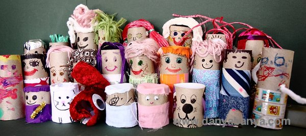A collection of 25 toilet paper roll dolls
