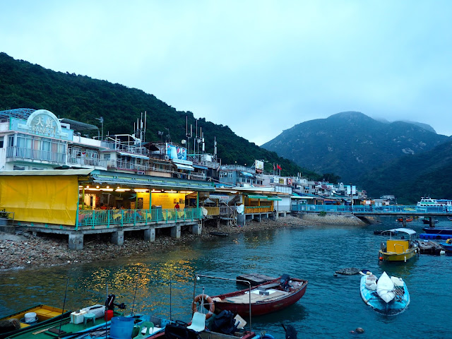Sok Kwu Wan village waterfront, with seafood restaurants and small fishing boats, on Lamma Island, Hong Kong