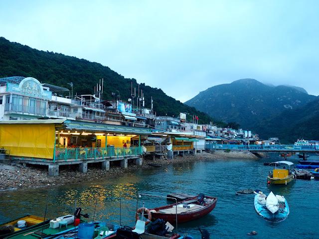 Sok Kwu Wan village waterfront, with seafood restaurants and small fishing boats, on Lamma Island, Hong Kong