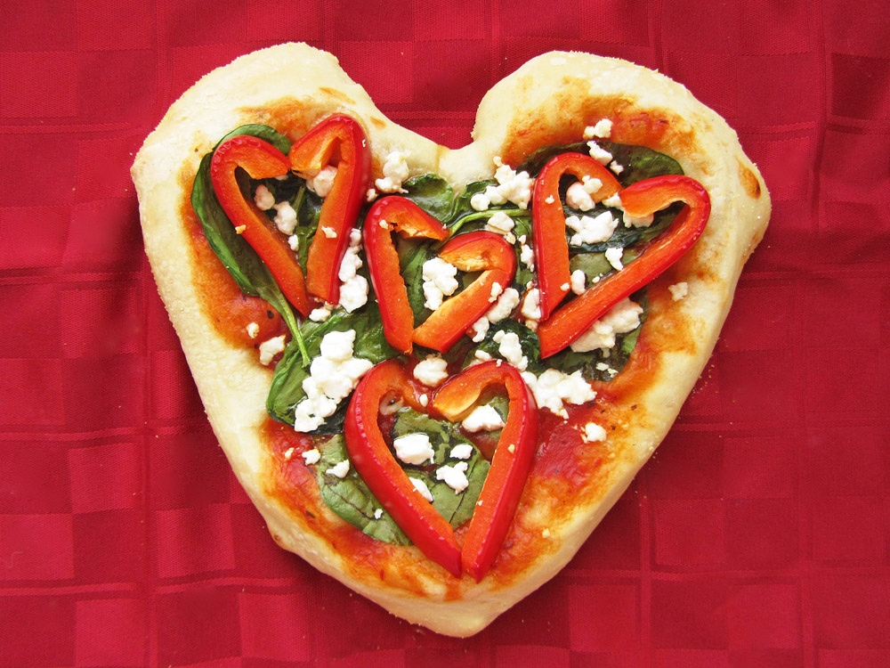 heart shaped red pepper personal pizza