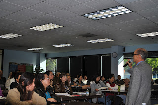 Bao Dinh (right, standing) discusses the naturalization process with members of the Vietnamese community in February, 2013