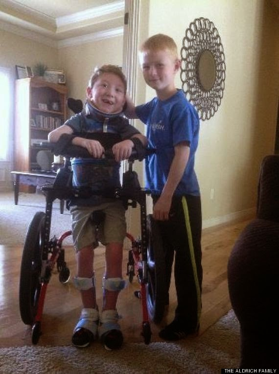 Very motivating indeed - This is Noah who's 8. He carried his disabled 6 year old brother through a triathlon.