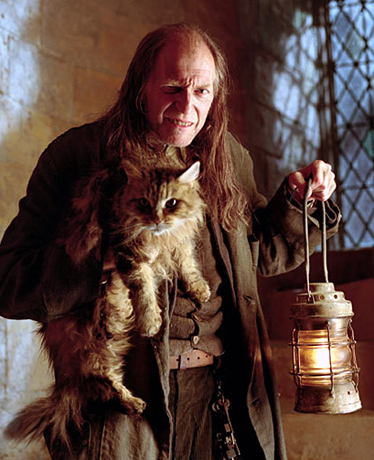 Mrs Norris with her owner, Argus Filch
