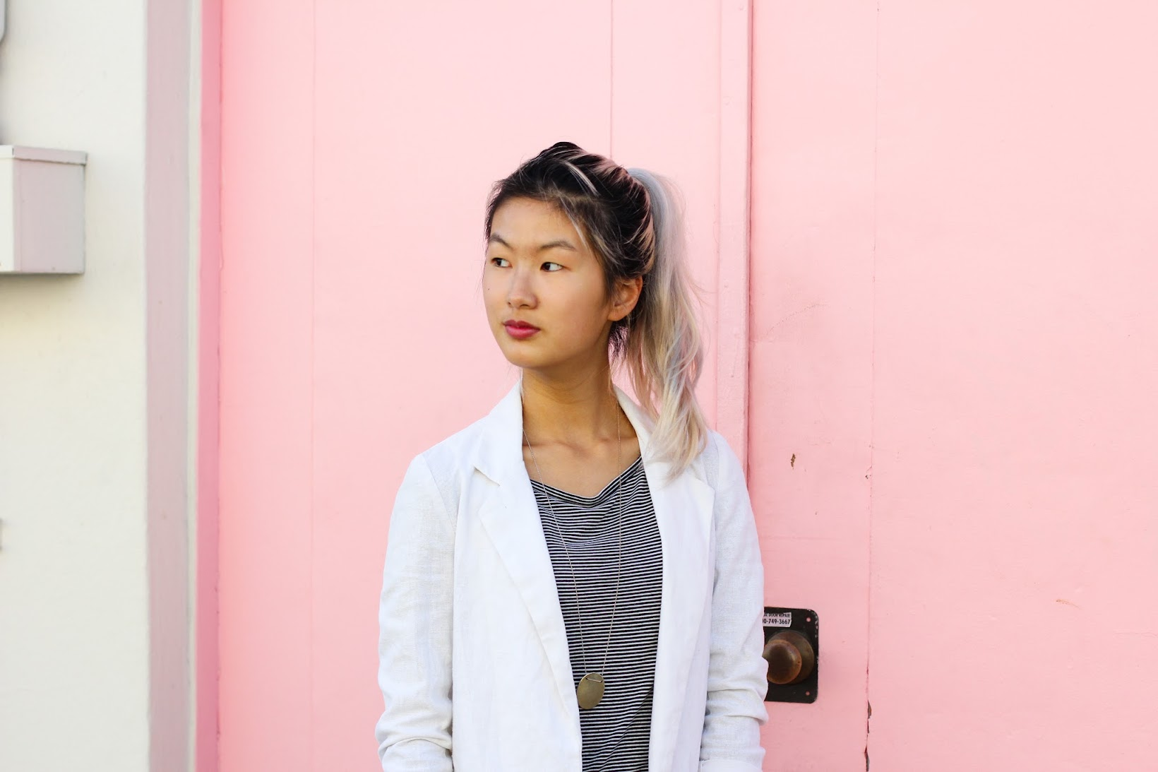 Juxtaposed mens-wear against a pink wall