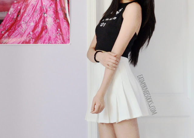 A Tumblr ulzzang-inspired monochromatic outfit featuring Dresslink's halter tie-back crop top and a white pleated American Apparel tennis skirt.