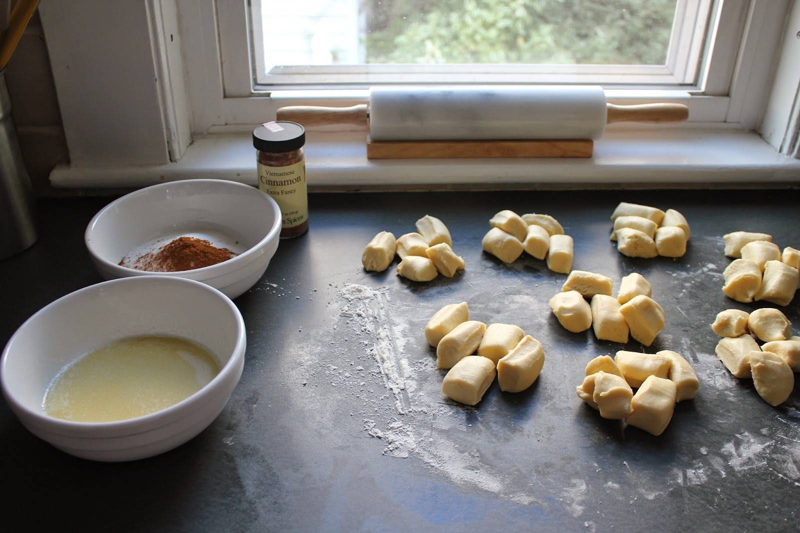 Making cinnamon-sugar brioche buns