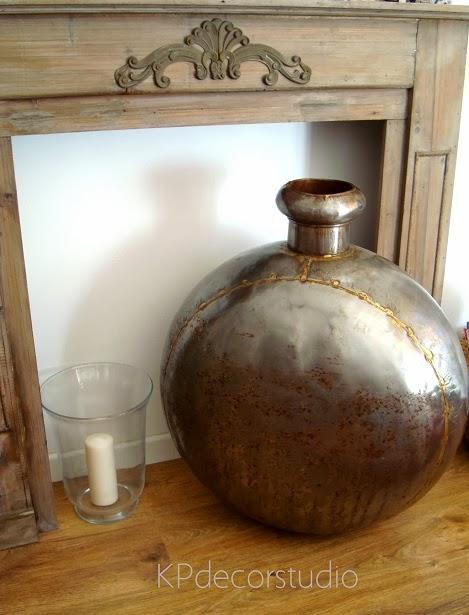 Comprar jarrones online. Jarrones grandes decorativos de metal oxidado.