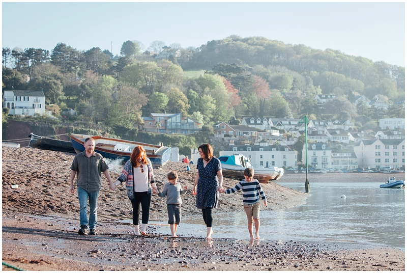 Helen Lisk and her family walking on the beach in Devon