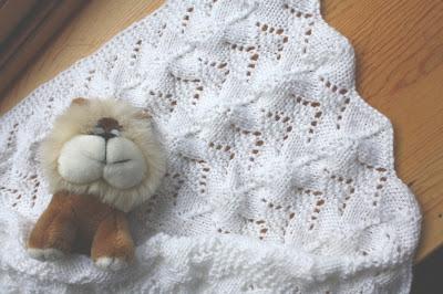 http://tashaknits.blogspot.com/2010/07/reversible-lace-baby-blanket-pattern.html