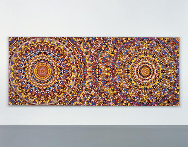 thousands of butterflies arranged in mandala circles on canvas