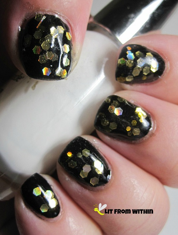 Polish Addict Breaking Dawn, a black jelly polish with gold hexes and a few bars
