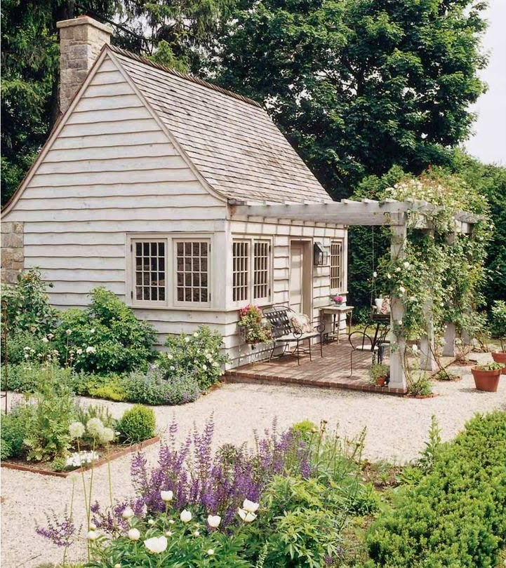 under the snow wherever this delightful garden cottage is located via