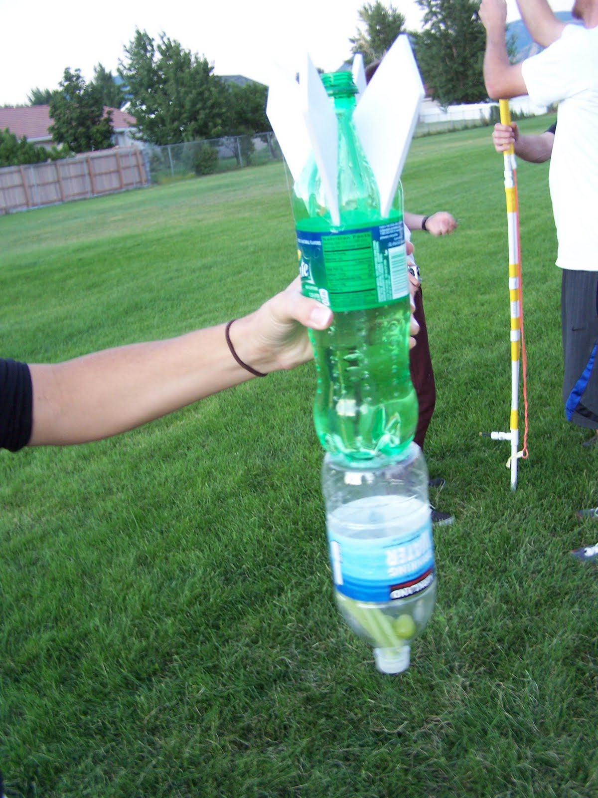 water bottle rockets Students are challenged to design and build rockets from two-liter plastic soda bottles that travel as far and straight as possible or stay aloft as long as possible.
