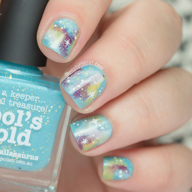 Turquoise Glittery Galaxy Nails