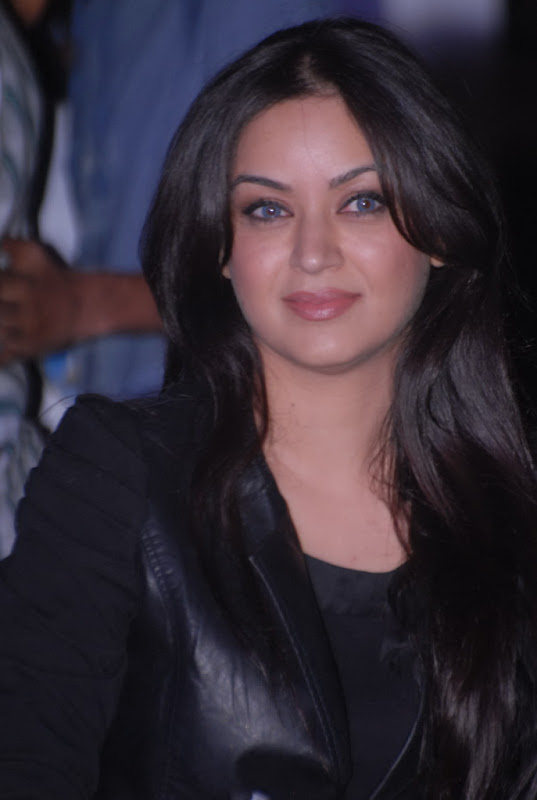 Maryam Zakaria with Rose Flower Bouquet in Black Jacket and Blue Jeans