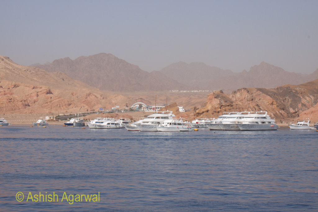 Large number of ships and yachts starting out from Sharm el Sheikh towards the snorkeling and scuba diving center