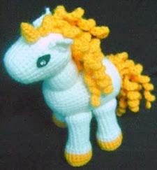 http://translate.google.es/translate?hl=es&sl=en&tl=es&u=http%3A%2F%2Fwww.mazkwok.com%2F2012%2F09%2Ffree-amigurumi-pattern-unicorn.html