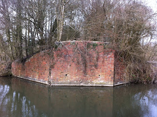 Supporting wall of brick bridge carrying the former Lambourn Valley railway line over the Kennet and Avon Canal, Newbury