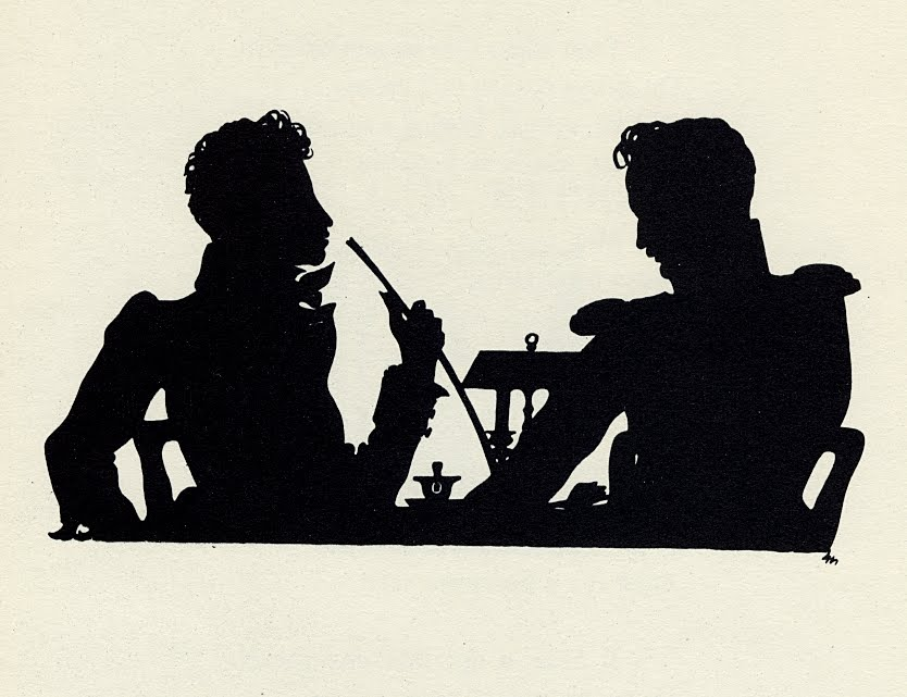 profile silhouette of 2 seated men at a table